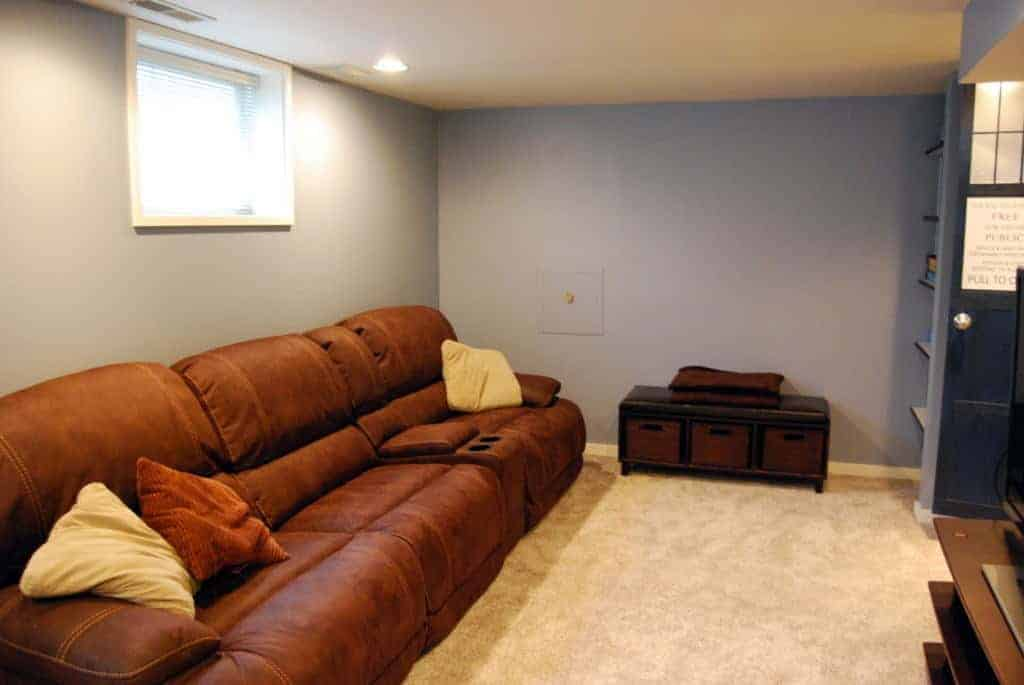 We installed carpet over tile in our basement, and now it's a cozy family room!
