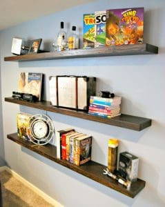 These DIY floating shelves help hide an eyesore on the wall and provide display space for books, games and geeky toys! - The Handyman's Daughter