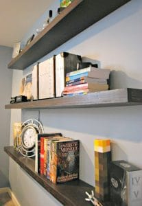 These DIY floating shelves are perfect for hiding an eyesore in the middle of the wall, and add display space to an otherwise blank wall - www.thehandymansdaughter.com