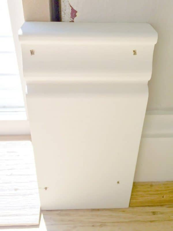 The plinth block fit perfectly in the gap between the threshold and the baseboards!