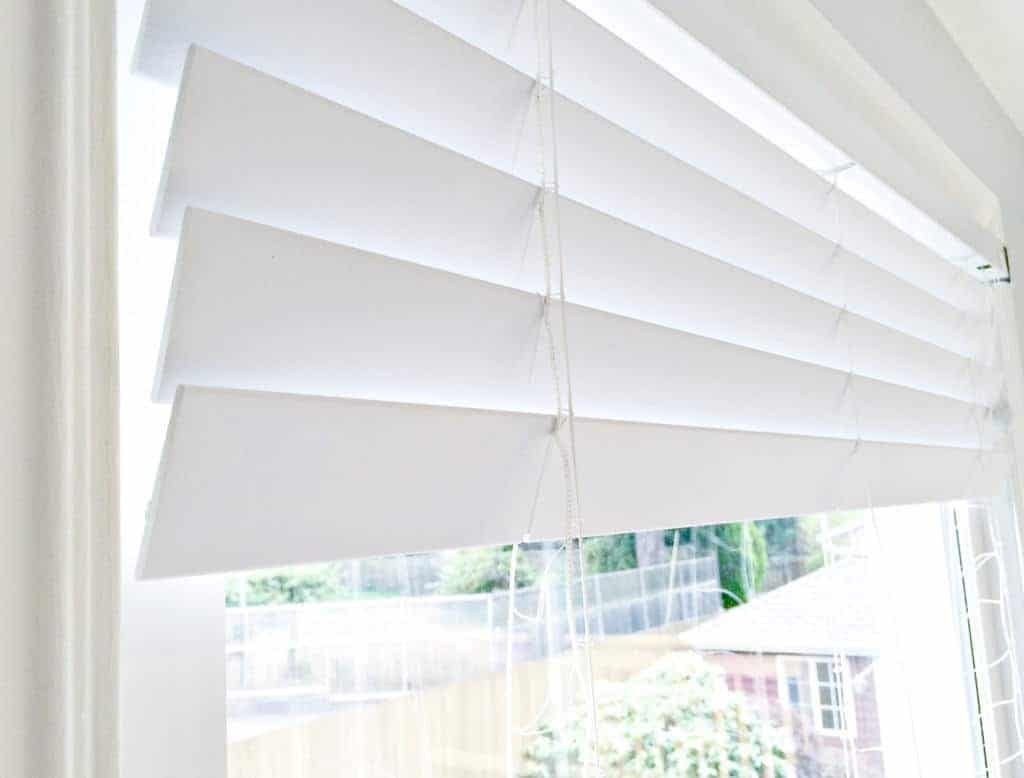Spray paint your vinyl blinds to give them a whole new look! These yellowed vinyl blinds look brand new again.
