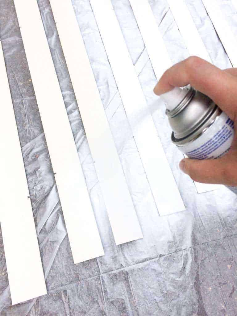 Spray paint the blinds with long, even passes.