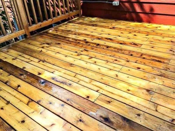 Before staining a new deck, give it a proper cleaning! You can see the difference clearly here.