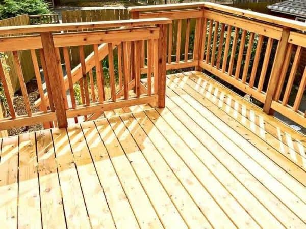 By waiting 6-12 months before staining a new deck, you allow the wood to dry out and lose the mill glaze on the surface.