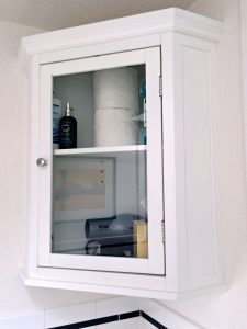 bathroom cabinet with stuff showing