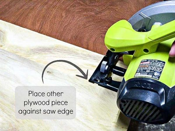 To create the fence for your circular saw jig, line up the other piece of plywood against the circular saw base.