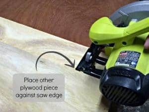 line up the other plywood strip with the other edge of the saw