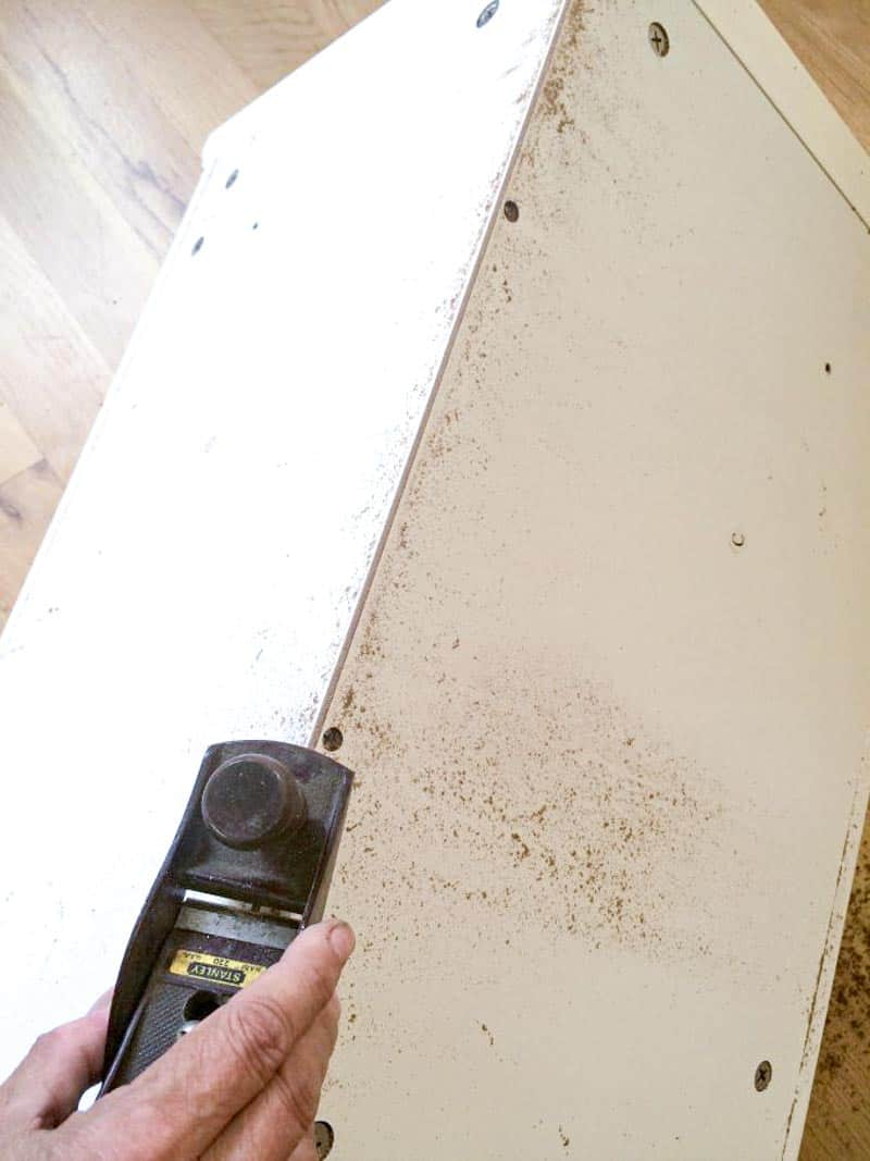 flattening back edge of corner cabinet before installation