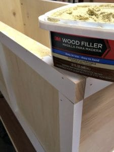 apply wood filler to all the cracks and holes