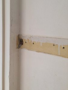 Oops! Hole in wall after removing coat hook board - The Handyman's Daughter
