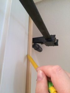 Mark the back of the door trim with a pencil to cut off the excess - The Handyman's Daughter