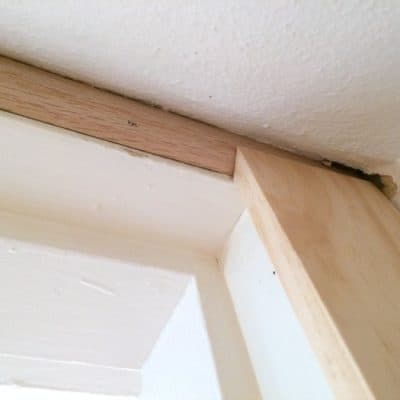 I cut the top of the door trim with a bevel to match up with the angle of the shoe moulding - The Handyman's Daughter