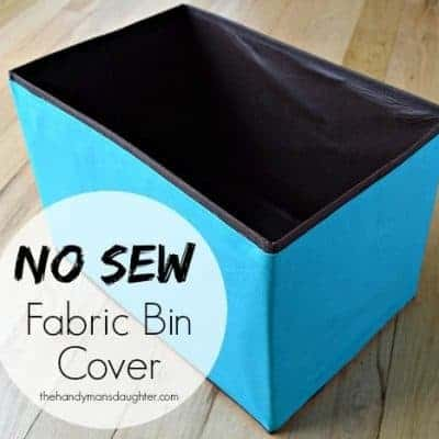 Changing up your decor but don't want to shell out money for more of those handy fabric bins in a new color? Follow this simple tutorial to cover those old bins with new fabric with no sewing required! - The Handyman's Daughter
