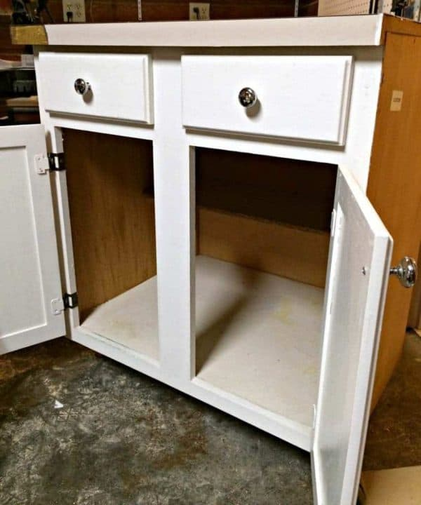 I picked up this kitchen cabinet with countertop from an architectural salvage warehouse. It had certainly seen better days! - The Handyman's Daughter