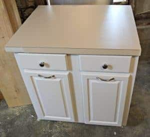 The cabinet is painted and the countertop damage has been spackled smooth. - The Handyman's Daughter