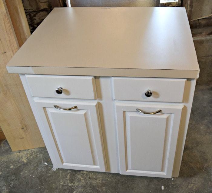 Salvaged kitchen cabinet with damaged laminate countertop
