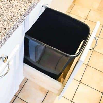Hide away that ugly trash can in a cabinet! This tutorial will show you how to convert a lower cabinet into a trash can cabinet easily.