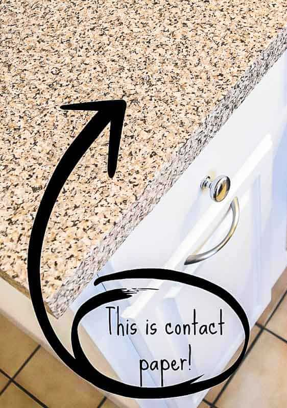 lower kitchen cabinet with contact paper countertop