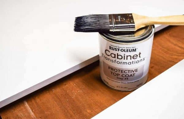 Apply the top coat to the 80's kitchen cabinet doors in an alternating pattern to avoid brush strokes.