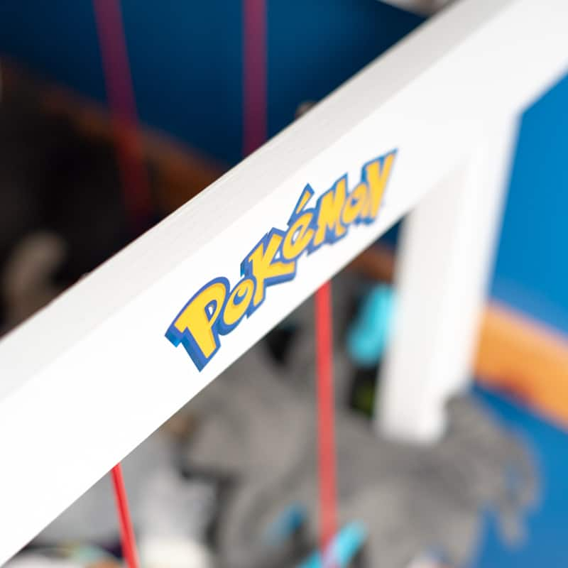 pokemon sticker on side of DIY stuffed animal zoo frame