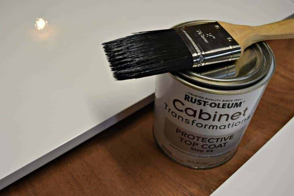 Check out that glossy top coat! These tips will help get the perfect finish on your freshly painted cabinet doors. - The Handyman's Daughter