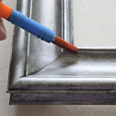Mix silver paint with black, to create a darker gray with a little shimmer. Then apply the paint to the creases and grooves to create more depth and contrast - thehandymansdaughter.com