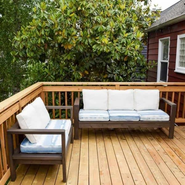 outdoor loveseat and sofa on wooden deck