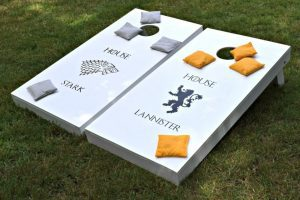These easy to make cornhole boards can be customized to any rivalry you can imagine! These Game of Thrones cornhole boards were the perfect Father's Day gift for my husband! - www.thehandymansdaughter.com