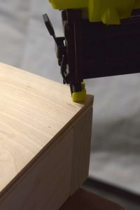 Attach the plywood top of your cornhole boards to the frame with nails or countersunk screws, making sure nothing sticks up above the surface of the wood - www.thehandymansdaughter.com