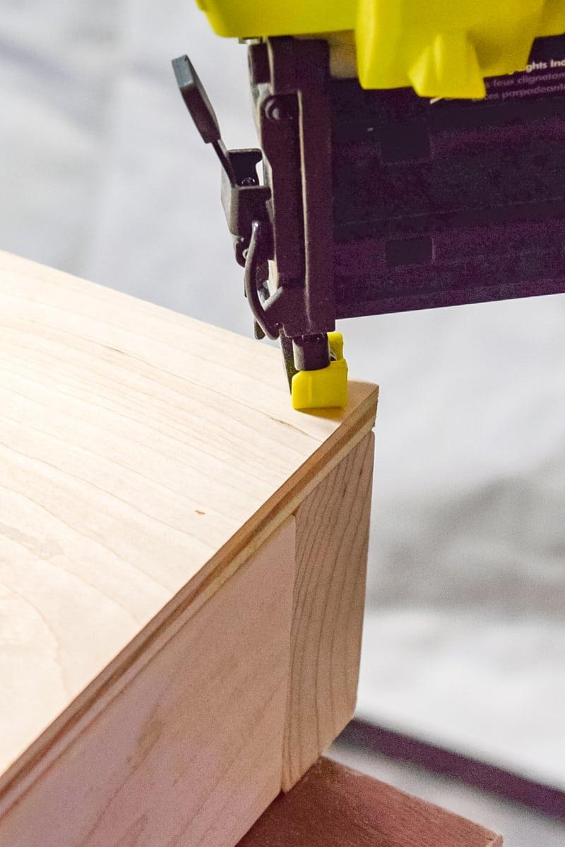 nailing cornhole board top to frame