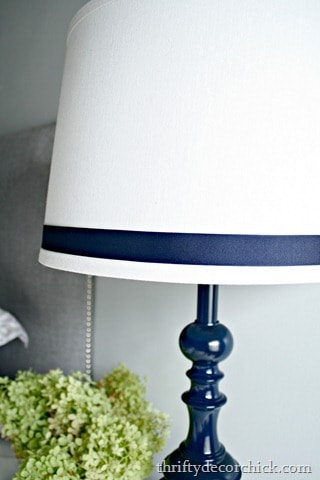 navy blue lamp with ribbon on lampshade