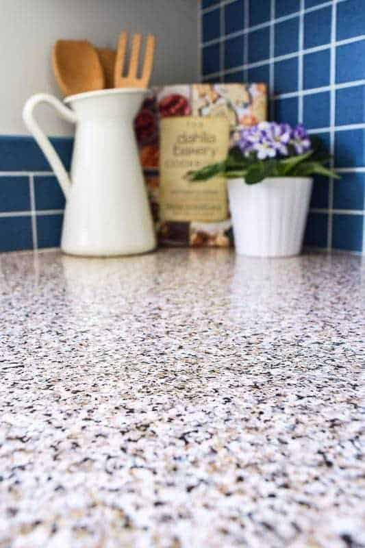 The ugly blue laminate countertop was covered with granite patterned contact paper.