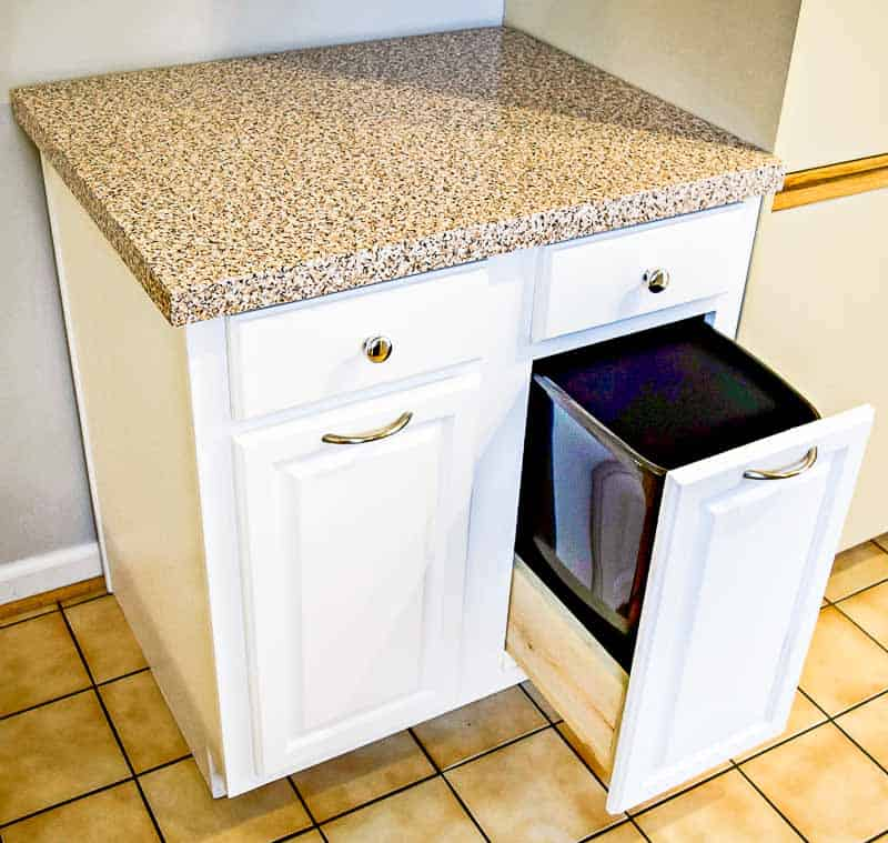 kitchen cabinet with pull out trash drawer