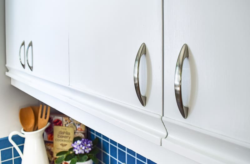 painted melamine cabinets with oak grab bars with new hardware
