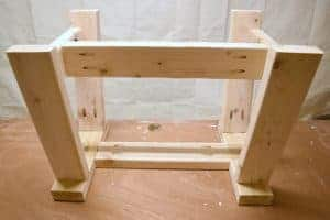 I shortened the length of the stretchers so the farmhouse bench would fit under our small table - www.thehandymansdaughter.com