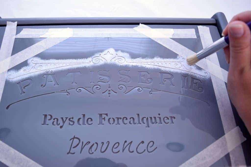 This French patisserie stencil brings a bit of charm to an otherwise boring gray bread box. - www.thehandymansdaughter.com