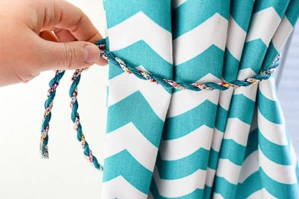 chevon pattern curtain with length of cord being measured for magnetic curtain tie back
