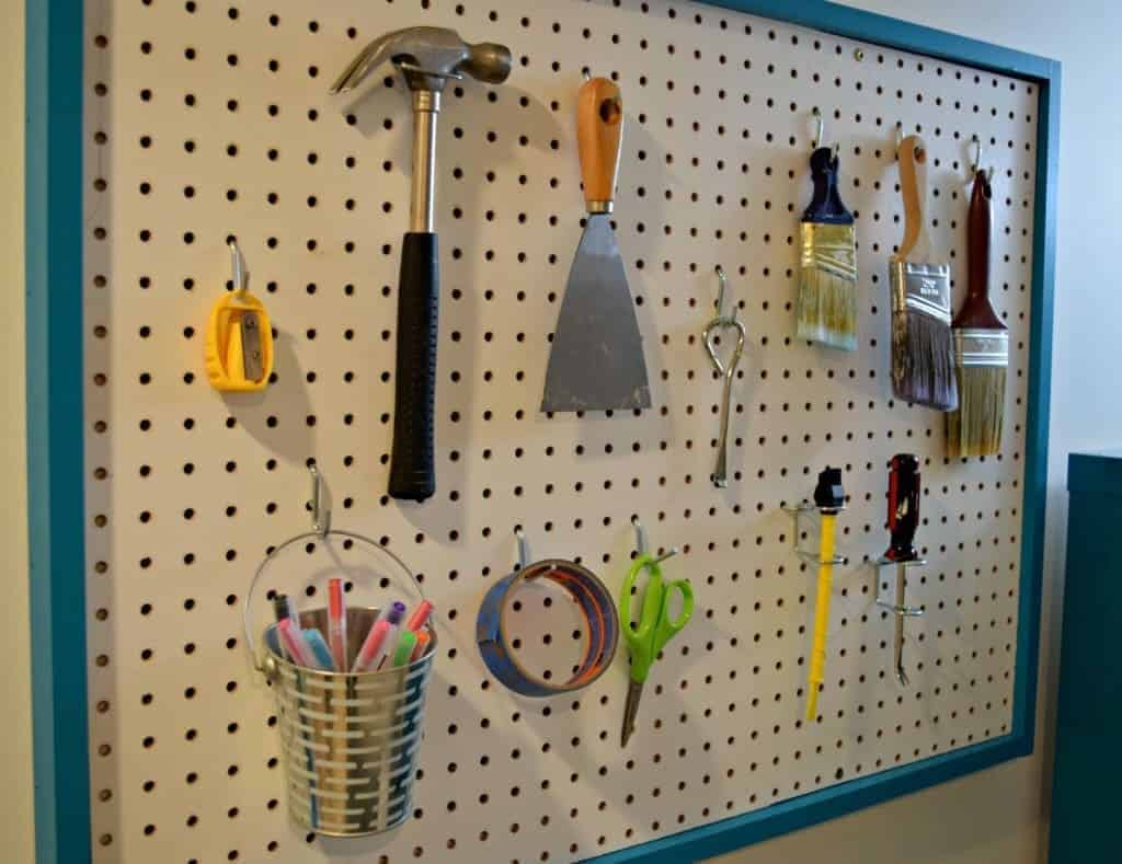 The pegboard was trimmed with the same bright turquoise color as the rest of the office makeover. - The Handyman's Daughter