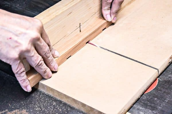 cutting vertical supports for DIY wall sconce on a table saw