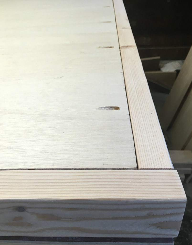 Attach the plywood to the headboard frame with 1 inch pocket hole screws - The Handyman's Daughter