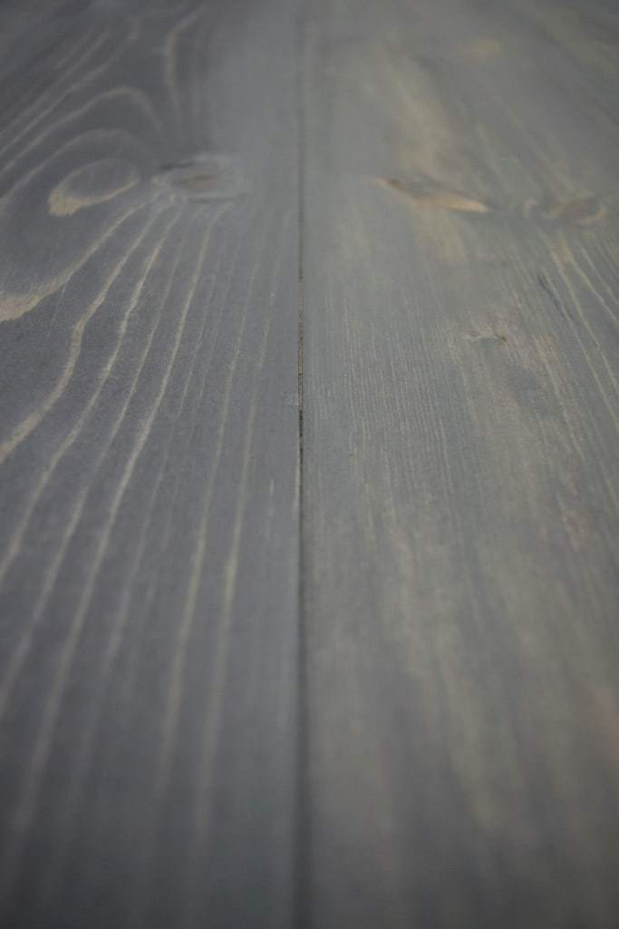 The boards for the desk were planked together and stained charcoal gray - The Handyman's Daughter