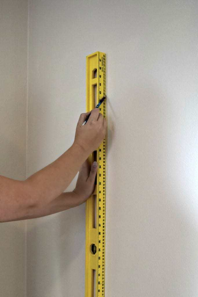 Draw a level vertical line a few inches less than the width of your wallpaper to mark as a starting point - The Handyman's Daughter