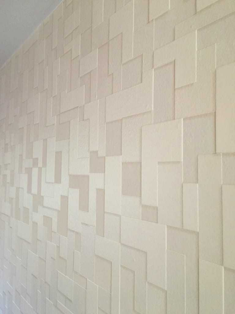 A textured wallpaper accent wall is the perfect way to make a space really pop! See how I hung this entire wall of amazing wallpaper by myself in just a few hours. - The Handyman's Daughter