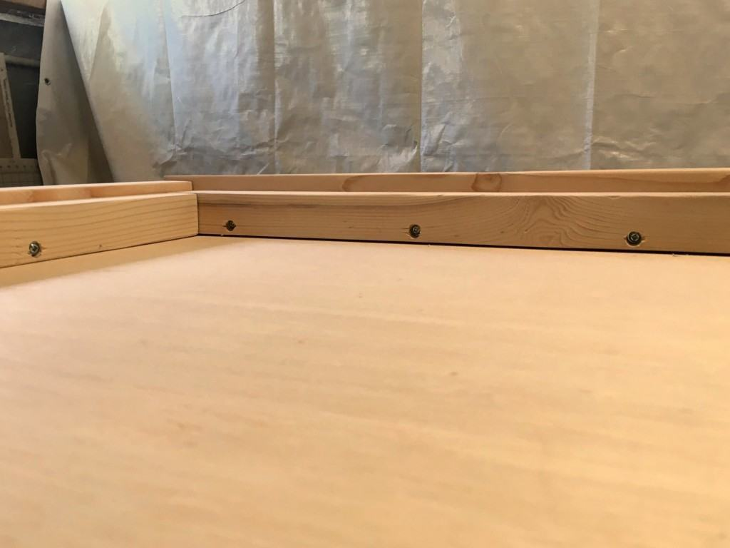 After attaching the 2 x 2 boards to the 2 x 3 boards, your leather headboard frame should look like this. - The Handyman's Daughter