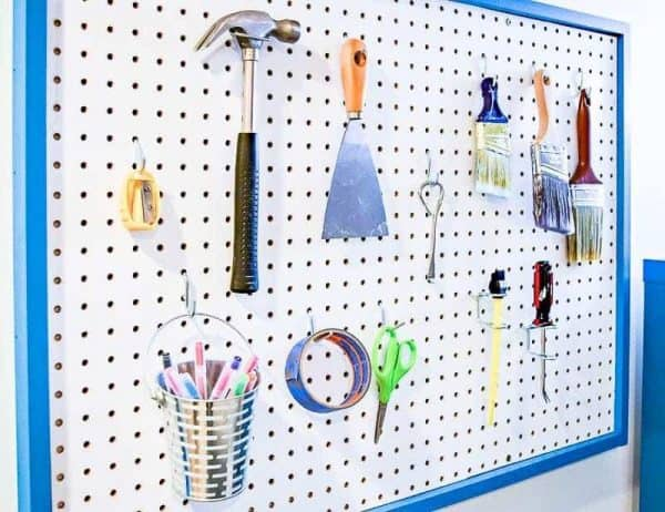 Adding a pegboard over the desk gives more function and storage to my office makeover.