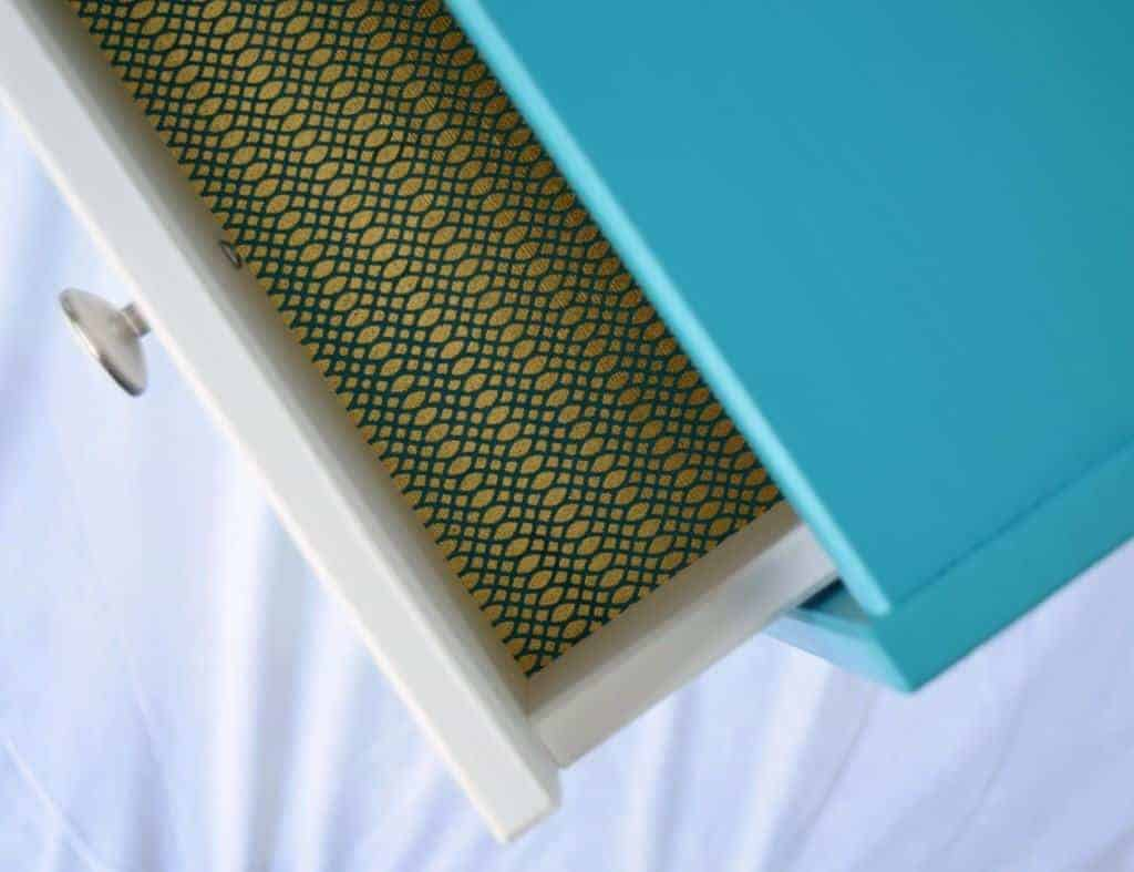 This beautiful paper was decoupaged to the bottom of the IKEA Rast drawer for extra pop! - The Handyman's Daughter