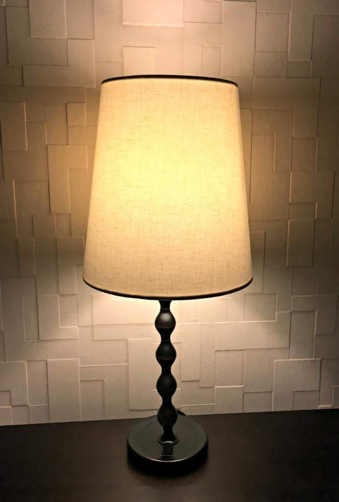 The glow of our nightstand lamps really shows off this amazing textured wallpaper. - The Handyman's Daughter