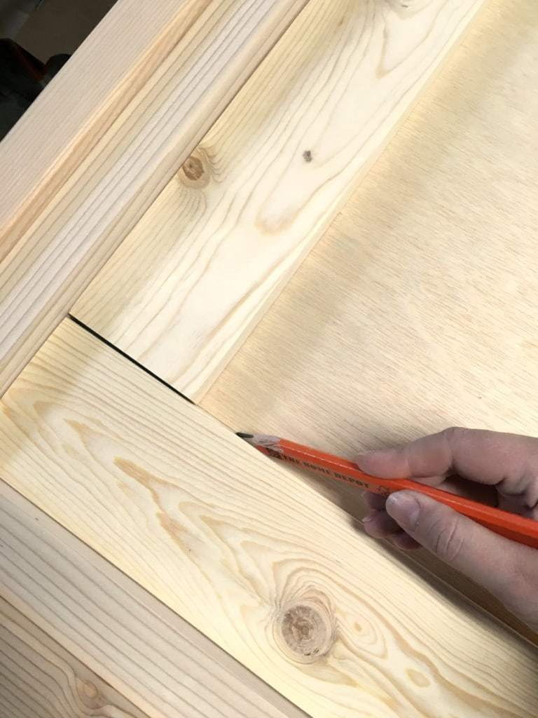 Mark the edge of the 1 x 4 board onto the plywood. This will be where you will line up your foam. - The Handyman's Daughter