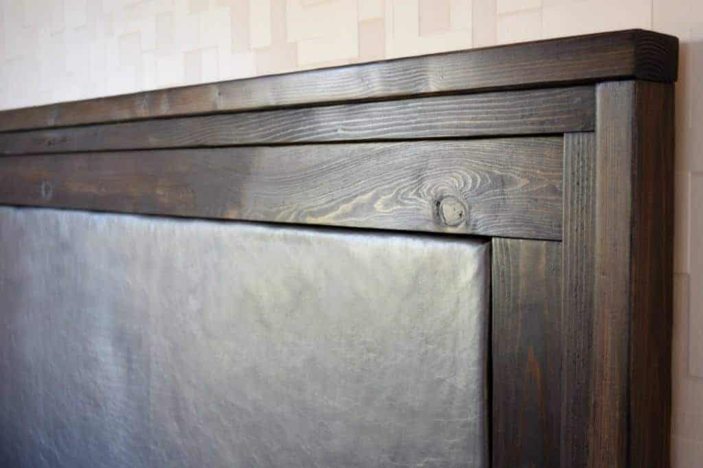 DIY Upholstered Leather Headboard with Stacked Wood Trim - Full Tutorial at www.thehandymansdaughter.com
