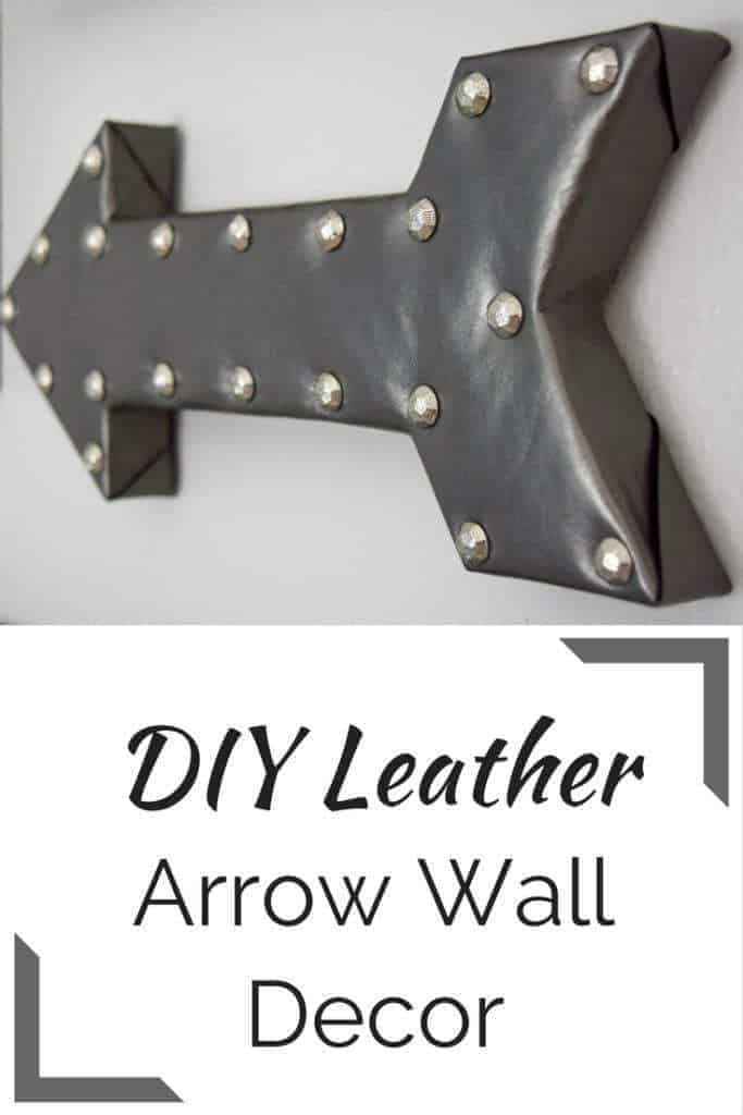 Arrow wall decor is a great way to break up a group of rectangular frames. See the full tutorial on how to make your own leather arrow at The Handyman's Daughter